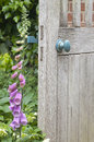 Secret garden entrance old wooden door in english Stock Photo