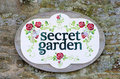 Secret garden sign on weathered stone wall Royalty Free Stock Image