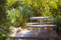Secret garden with stone table and sunlight Royalty Free Stock Image