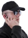 Secret service closeup of man using headset for communication Stock Photo
