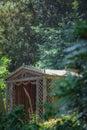 Secret summer house. Ornamental wooden trellis garden gazebo sea Royalty Free Stock Photo
