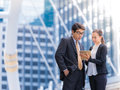 Secretary helping boss Confident business partners consulting in city background. Royalty Free Stock Photo