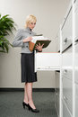 Secretary looking at files Royalty Free Stock Photo