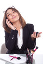 Secretary in the make up work talking on phone Royalty Free Stock Images