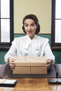 Secretary receiving a surprise box at office Royalty Free Stock Photo