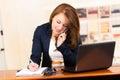 Secretary using cell phone Royalty Free Stock Photo