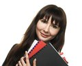 Secretary young woman with folders in her hands Royalty Free Stock Image
