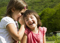 Secrets of children two twin little sister girls whisper in the ear Royalty Free Stock Photography