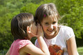Secrets of children two twin little sister girls whisper in the ear Stock Photos