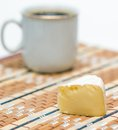 A section of brie cheese with cup coffee on background Stock Photography