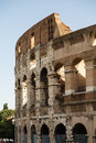 Section of roman coliseum under blue a the old in rome italy Stock Photo