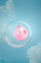 Secure savings piggy bank floating in a soap bubble in the sky Stock Photos