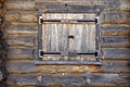 Secured log house window wall with closed shutter Royalty Free Stock Photos
