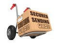 Secured sending cardboard box on hand truck with slogan isolated white Stock Photo