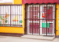 Secured store metal grid fence in front of an entrance Royalty Free Stock Photo