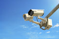 Security camera on blue sky background Royalty Free Stock Photo
