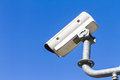 Security camera or cctv against blue sky on roadside Royalty Free Stock Photo