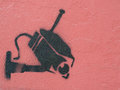 Security camera graffiti image of a on a brick colored wall Stock Images
