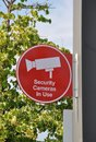 Security camera in use sign Royalty Free Stock Photo