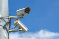 Security cameras with blue sky pole under Royalty Free Stock Images