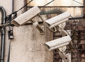 Security cameras three frontal view on concrete wall Stock Images