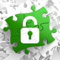 Security concept on green puzzle pieces icon of opened padlock located Royalty Free Stock Photo
