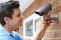 Security Consultant Fitting Security Camera To House Wall Royalty Free Stock Photo
