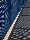 Security fence barrier casting a shadow in bright sunlight Stock Photography