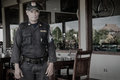 Security guard bali indonesia canggu standing in front of a deus exmachina restaurant in Royalty Free Stock Photo