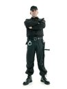 Security guard man wearing black uniform equipped with police club and handcuffs standing confidently with arms crossed shot on Royalty Free Stock Photo