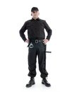 Security guard man wearing black uniform equipped with police club and handcuffs standing confidently with hands resting on hip Stock Photos