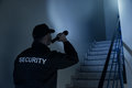 Security Guard Searching On Stairway With Flashlight Royalty Free Stock Photo