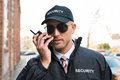 Security Guard Talking On Walkie-talkie Royalty Free Stock Photo