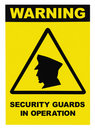 Security guards in operation text warning sign Royalty Free Stock Images