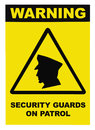 Security guards on patrol warning text sign label, isolated, black, yellow, large detailed macro closeup Royalty Free Stock Photo