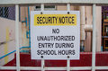 Security notice no unauthorized entry during school hours sign Royalty Free Stock Images
