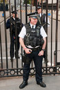 Security officers in front of the Downing Street 1 Royalty Free Stock Photo