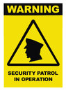 Security patrol in operation text warning sign label, isolated, large detailed vertical closeup Royalty Free Stock Photo