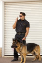 Security patrolman guard dog patrol checking out a warehouse or industrial office building Royalty Free Stock Photography