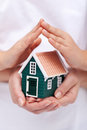 Security and safety concept insurance with house protected by hands Stock Photos