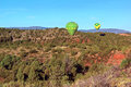 Sedona balloon landing a pair of hot air balloons coming in for a near arizona because it is impossible to obtain a property or Stock Photos