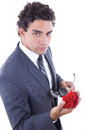 Seducer in suit holding rose Royalty Free Stock Photo
