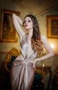 Seductive brunette woman in luxury manor vintage style young beautiful luxurious long elegant dress beautiful young a luxurious Royalty Free Stock Image