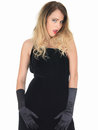 Seductive coy young woman wearing black dress attractive Stock Photos