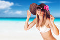 Seductive female on the beach wearing big stylish hat and sunglasses sunbathing sandy coast luxury resort summer holiday and Royalty Free Stock Photos