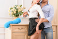Seductive female housekeeper kissing Royalty Free Stock Photo