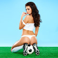 Seductive female soccer player in an erotic pose Royalty Free Stock Photo