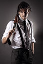 Seductive gangster with shotgun handsome fashion model dressed like a posing grey backdrop portrait Royalty Free Stock Photography