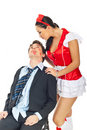 Seductive nurse with kissed businessman Stock Photography