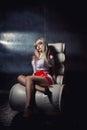 Seductive nurse sitting on an armchair in a morgue Stock Photos
